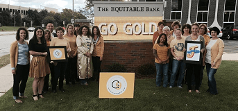 Gold in September Equitable Bank Employees with Sign Sep 2015